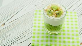 Glass with kiwi and yogurt stock video