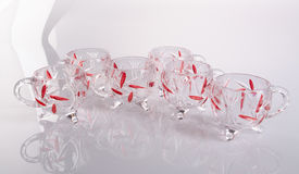 Glass kopp Glass kopp på en bakgrund Glass kopp på en bakgrund Arkivfoto