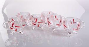 Glass kopp Glass kopp på en bakgrund Glass kopp på en bakgrund Arkivbilder