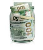 Glass krus med pengar på vit bakgrund Royaltyfri Bild