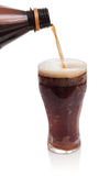 Glass of kvass with flow from bottle Stock Photos