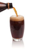 Glass of kvass with flow from bottle Royalty Free Stock Photos