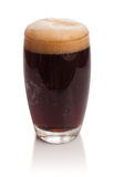 Glass of kvass with froth Royalty Free Stock Photography
