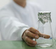 Glass lab beaker and foil Stock Image
