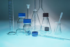 Glass laboratory apparatus on blue table. Glass laboratory apparatus isolated on blue table Royalty Free Stock Image