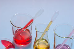 Glass laboratory apparatus with color water Stock Image