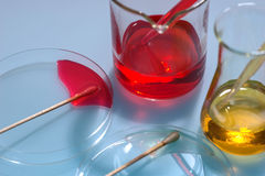 Glass laboratory apparatus with color water Royalty Free Stock Photo