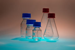 Glass laboratory apparatus isolated on blue table Royalty Free Stock Images