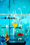 Glass laboratory apparatus. With liquid samples Royalty Free Stock Photo