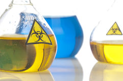 Glass laboratory equipment with symbol biohazard Stock Image