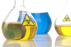 Glass laboratory equipment with symbol biohazard Stock Photo