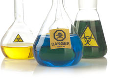 Glass laboratory equipment with symbol biohazard and danger Stock Image