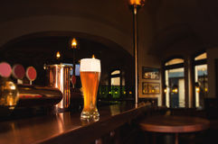Glass of lager beer. On bar of restaurant Royalty Free Stock Image