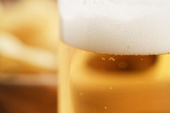 Glass of lager beer closeup on wooden table Stock Photography