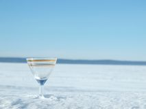 Glass, lake and snow Royalty Free Stock Photography