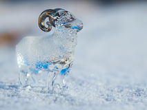 Glass lamb in the snow. 2015 - year of a sheep on east calendar Stock Photo