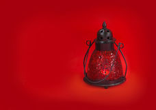 Glass lamp on a red background Stock Photography