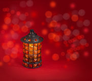 Glass lantern on a red background Royalty Free Stock Photo