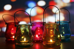 Glass lanterns on wooden table royalty free stock photography