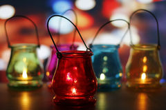 Glass lanterns on wooden table Stock Image