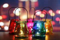Glass lanterns on wooden table Stock Photos