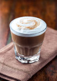 Glass of Latte Coffee. Glass of cafe au lait on brown napkin Stock Images