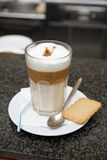 Glass of latte coffee on bar counter Royalty Free Stock Image