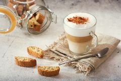 Glass of latte coffee. With cookies royalty free stock photos