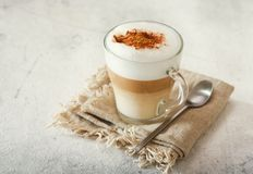 Glass of latte coffee. On old table stock photography