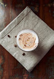 Glass of latte coffee topped with cocoa Royalty Free Stock Photography