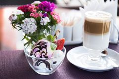 Glass of latte and ice cream. Fresh ice cream and coffee served stock photo