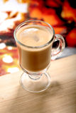 Glass of latte macchiato coffe on wooden table Royalty Free Stock Images