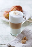 Glass of Latte Macchiato and Croissant Royalty Free Stock Photos