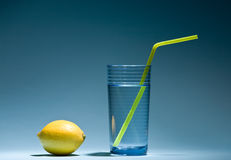 Glass and lemon Stock Images