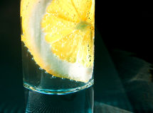 Glass with lemon and bubbles. Close up glass with lemon and bubbles Royalty Free Stock Image