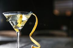 Glass of lemon drop martini cocktail in bar, closeup. Space for text stock image