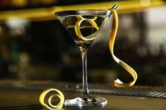 Glass of lemon drop martini cocktail. On bar counter royalty free stock images