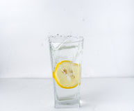A glass with a lemon Royalty Free Stock Images
