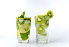 A glass with lemon and ice kiwi Royalty Free Stock Photos