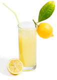 Glass of lemon juice and fruit with leaves Royalty Free Stock Image