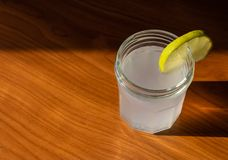 The glass of lemon juice with the slice of lemon royalty free stock photos