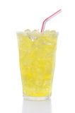 Glass Lemon Lime Soda with Drinking Straw. A glass of Lemon Lime soda filled with ice cubes, soda and a straw over a white background Stock Photos