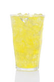 Glass of Lemon Lime Soda and Ice. A glass of Lemon Lime soda filled with ice cubes over a white background, with reflection Stock Image
