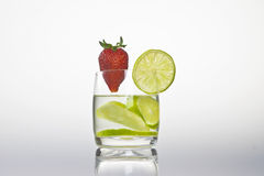 Glass with lemon and strawberry. A glass with lemon and strawberry Royalty Free Stock Photo