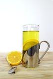Glass of lemon tea. On light background stock photo