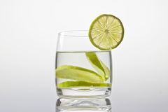 Glass with lemonade. And lemon slice Royalty Free Stock Images
