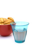 Glass with lemonade and a bowl with cookies Royalty Free Stock Photography