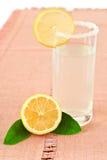 Glass of lemonade and lemon Stock Photo