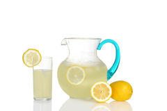 Glass of lemonade with pitcher. Closeup of glass of lemonade with pitcher Stock Photo