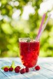 Glass of lemonade with raspberries Royalty Free Stock Photos